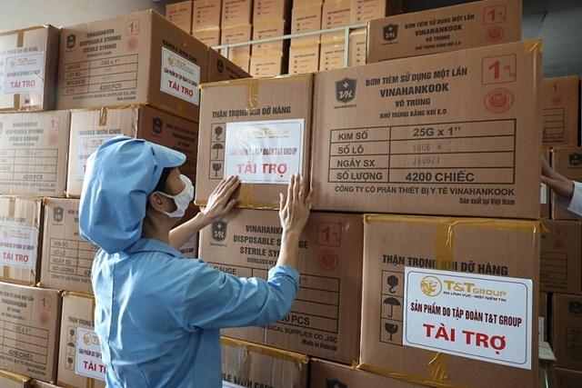T&T Group tài trợ toàn bộ bơm kim tiêm cho chiến dịch tiêm 150 triệu liều vắc xin phòng COVID-19 - Ảnh 1