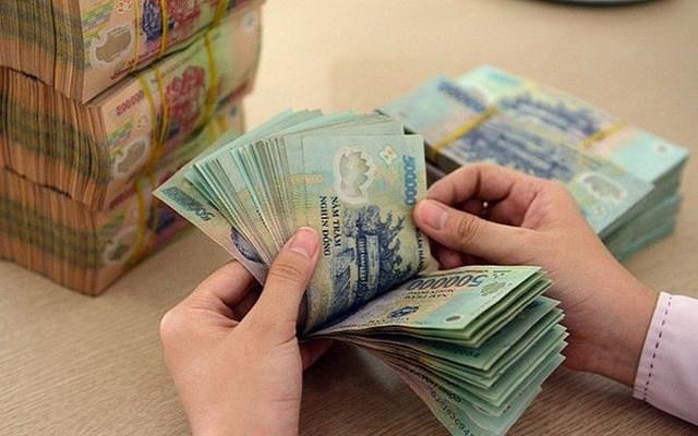 Nhu cầu gửi tiền của người dân giảm mạnh - Ảnh 1