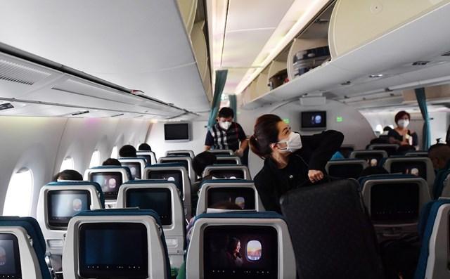 Vì sao Hà Nội phải cách ly tập trung 7 ngày đối với người bay đến từ TP.HCM? - Ảnh 1