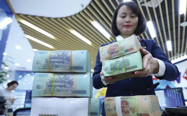 Cuối năm, các ngân hàng vay mượn nhau hơn 100 nghìn tỷ đồng mỗi ngày - Ảnh 1